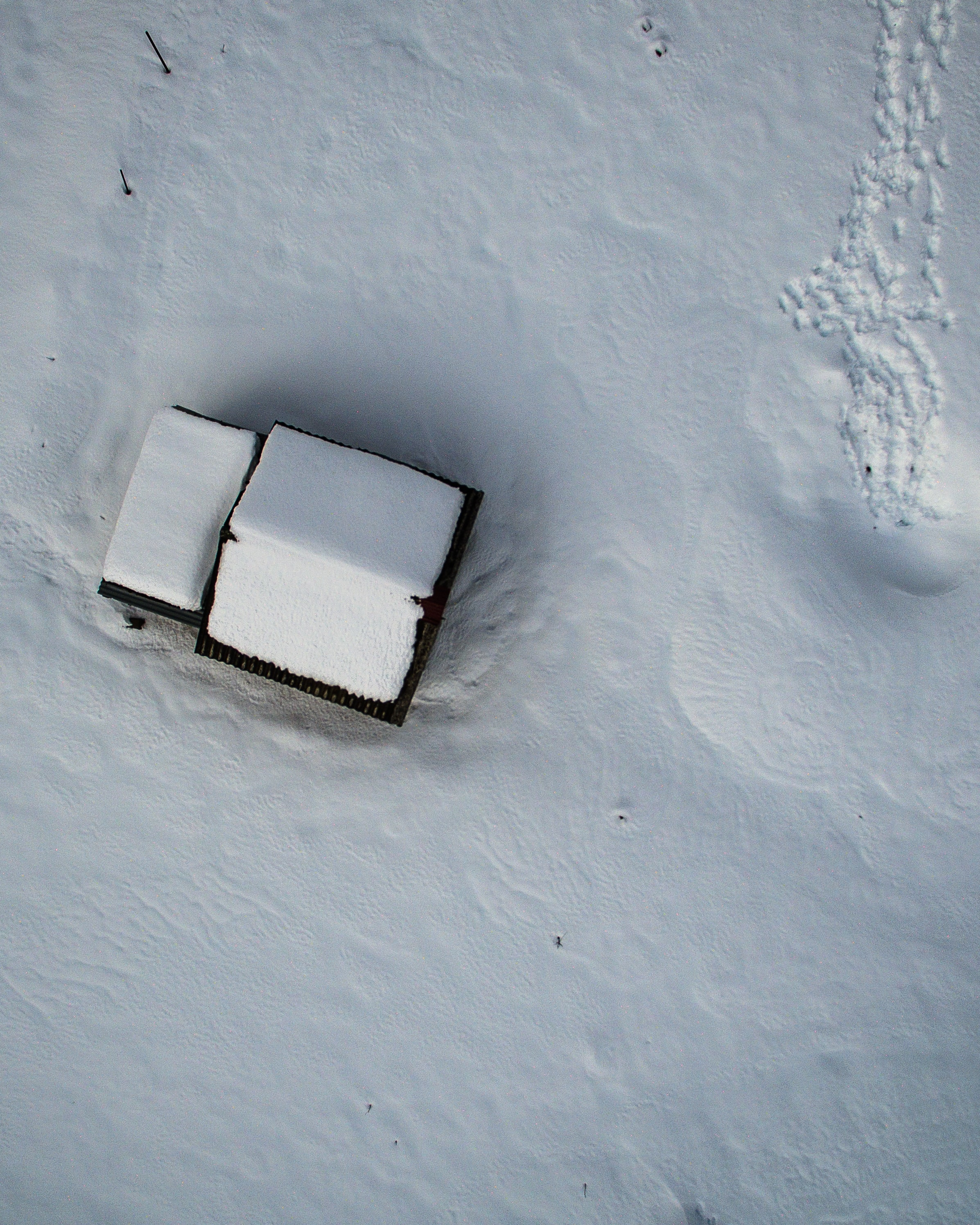 birds eye photography of house covered with snow