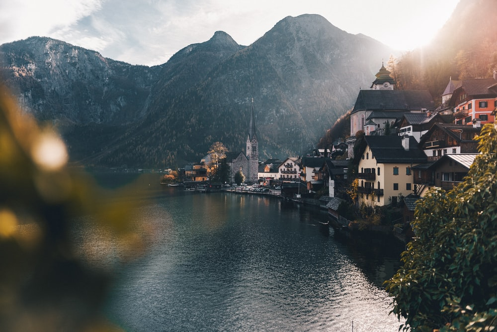 town beside body of water and mountains