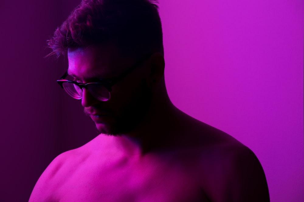 topless man wearing black framed eyeglasses
