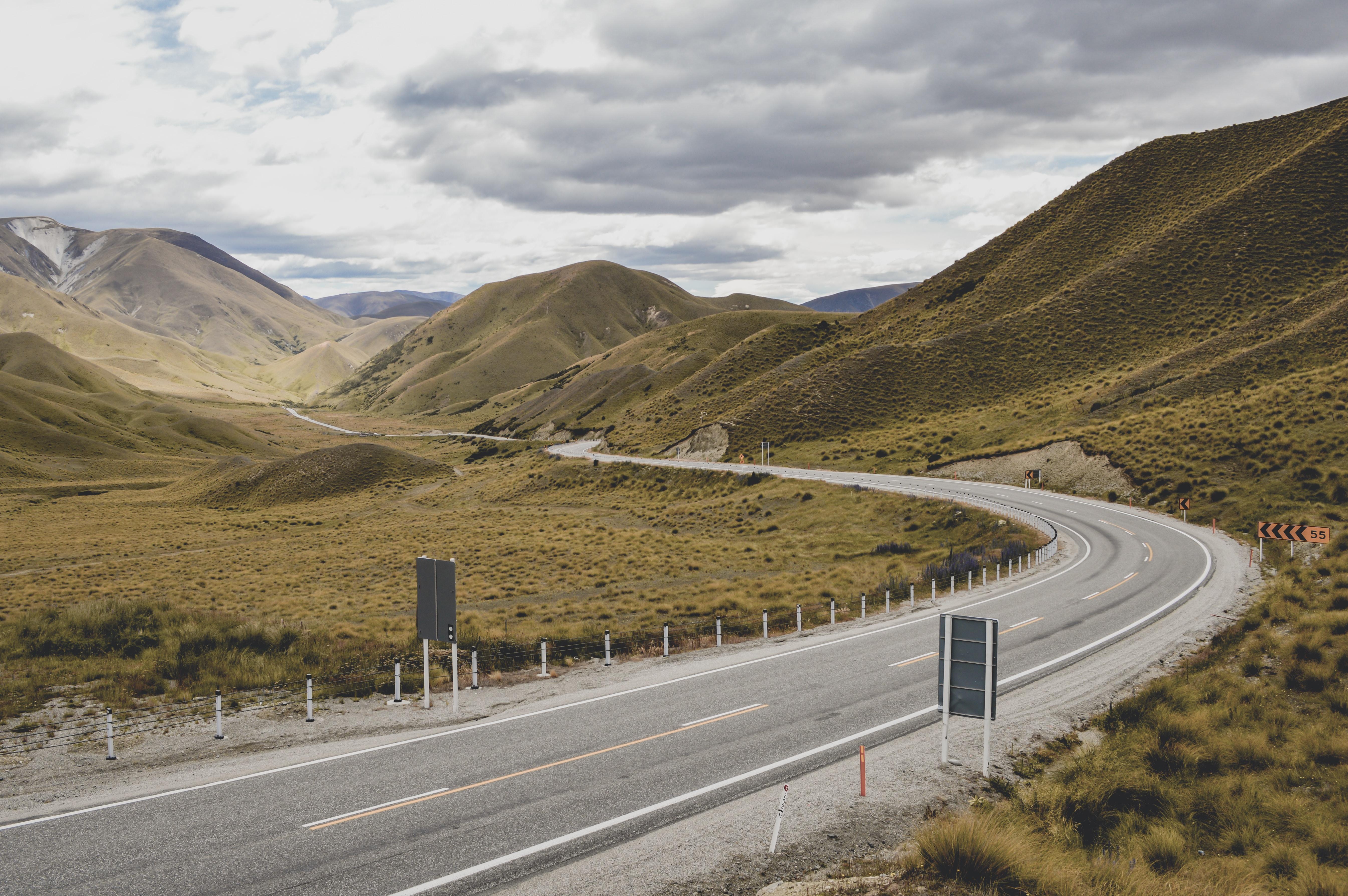 asphalt road between mountain
