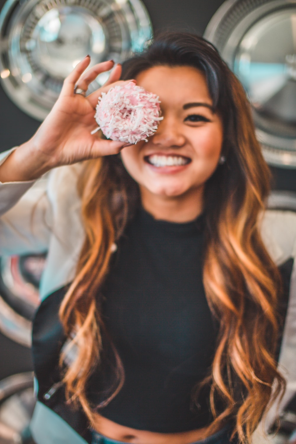 woman holding round strawberry pastry