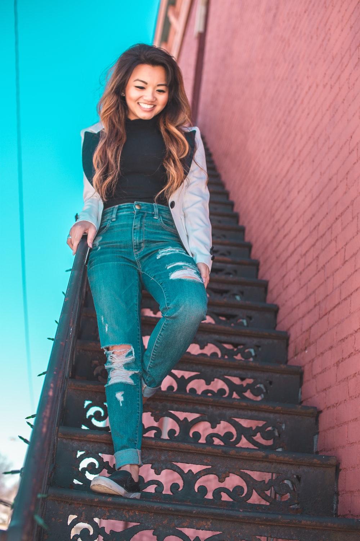 woman walking down to staircase