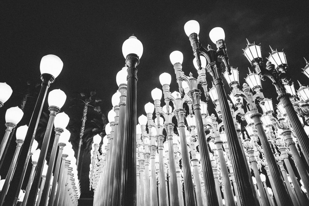 grayscale photography of lamp posts