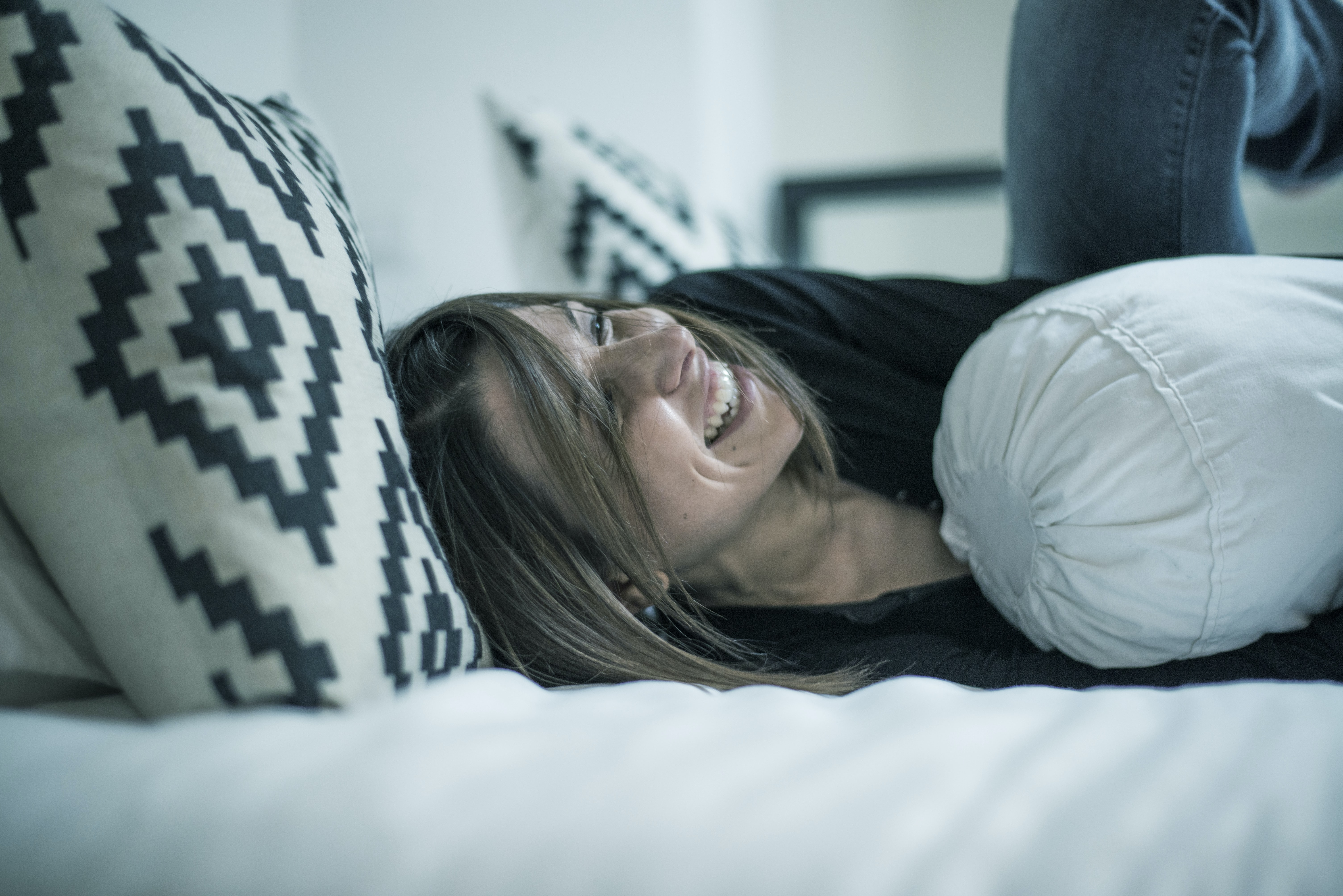 woman lay on bed