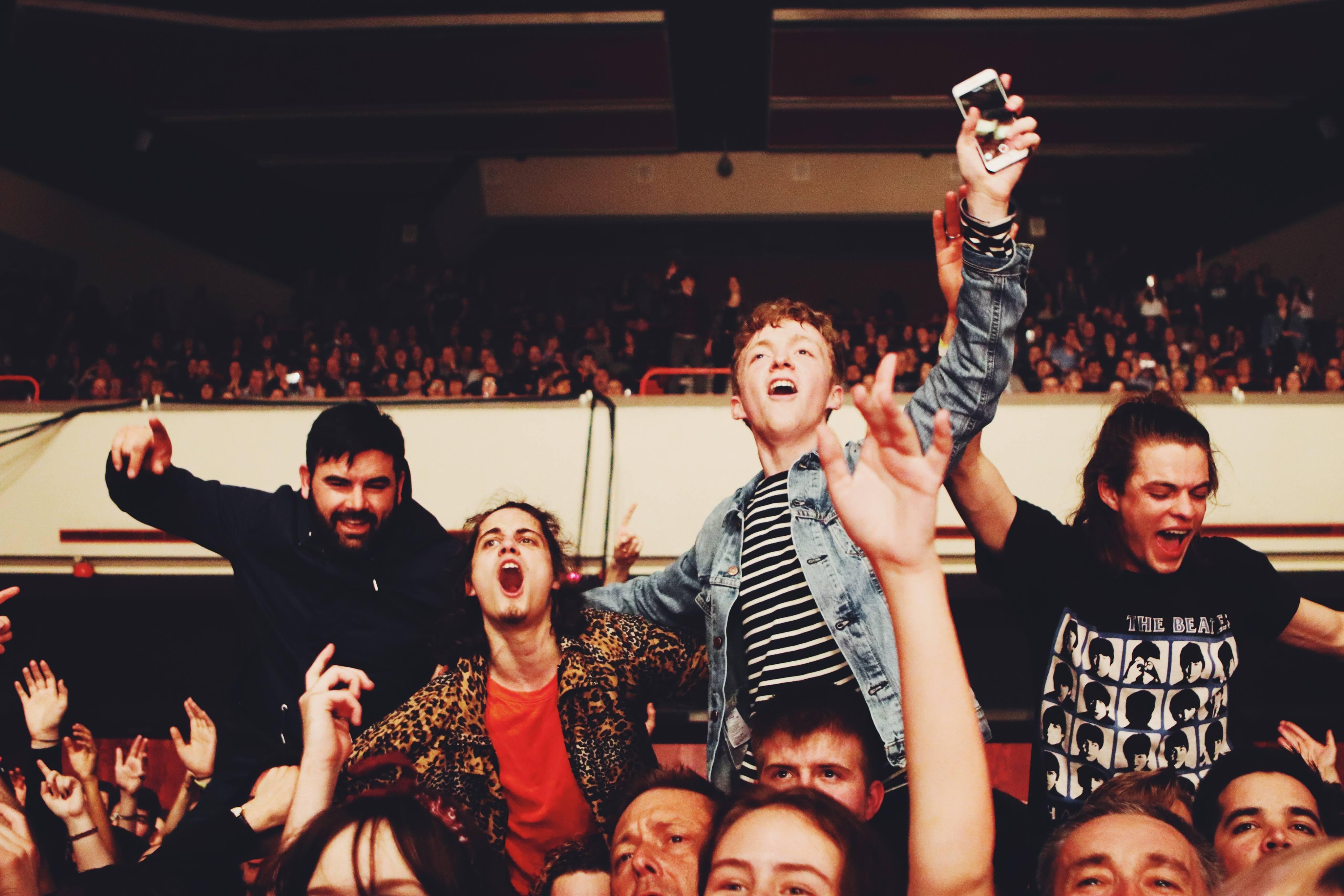 group people cheering inside the stadium
