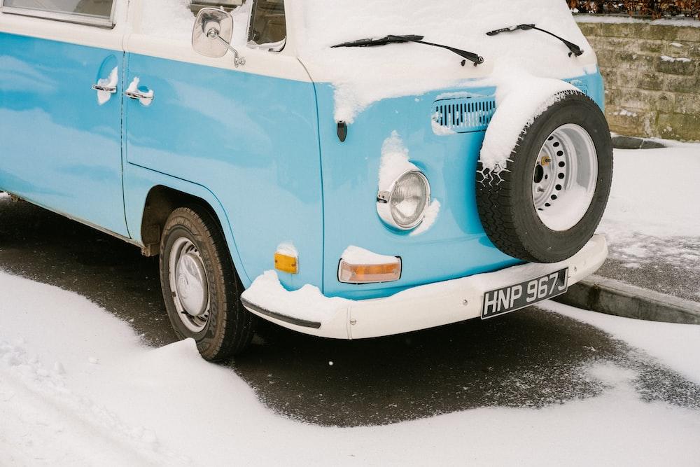 photo of teal and white Volkswagen Type 2 T2 van