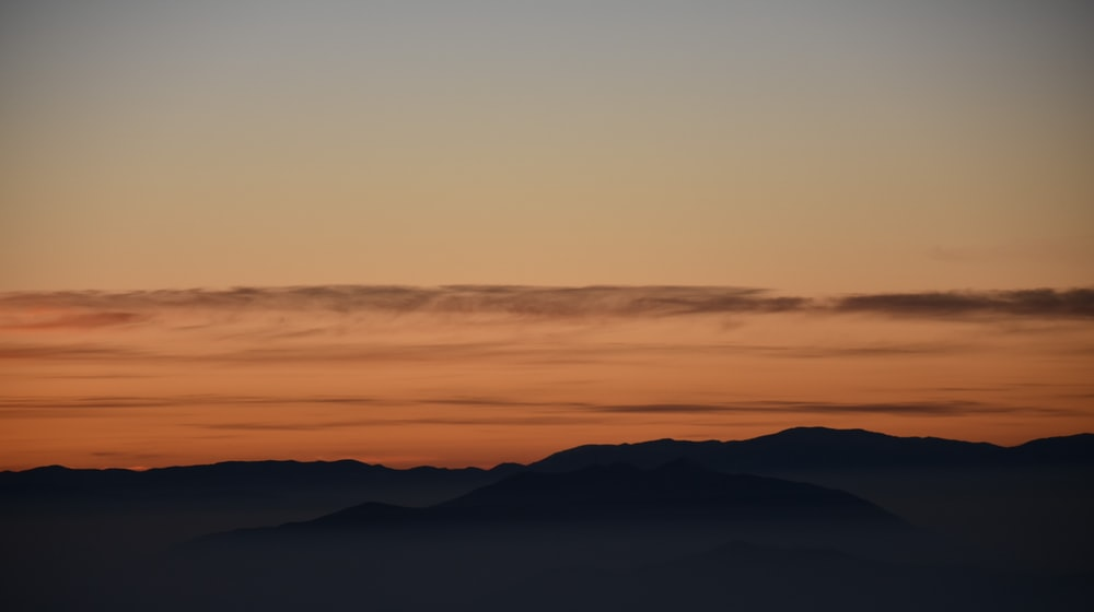 silhouette photography of mountain during golden hours