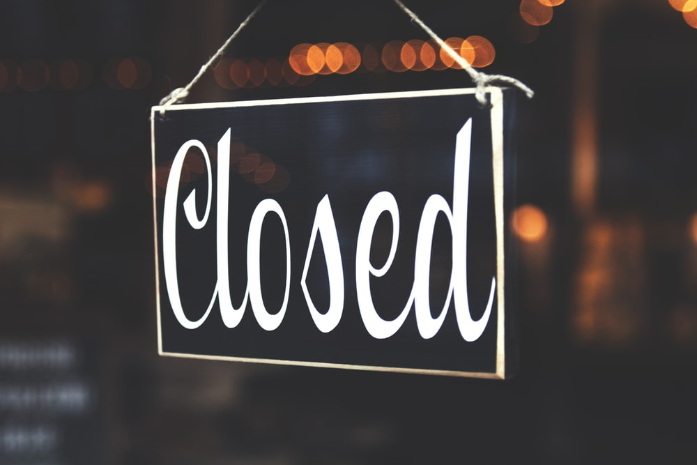bokeh photography of closed signage
