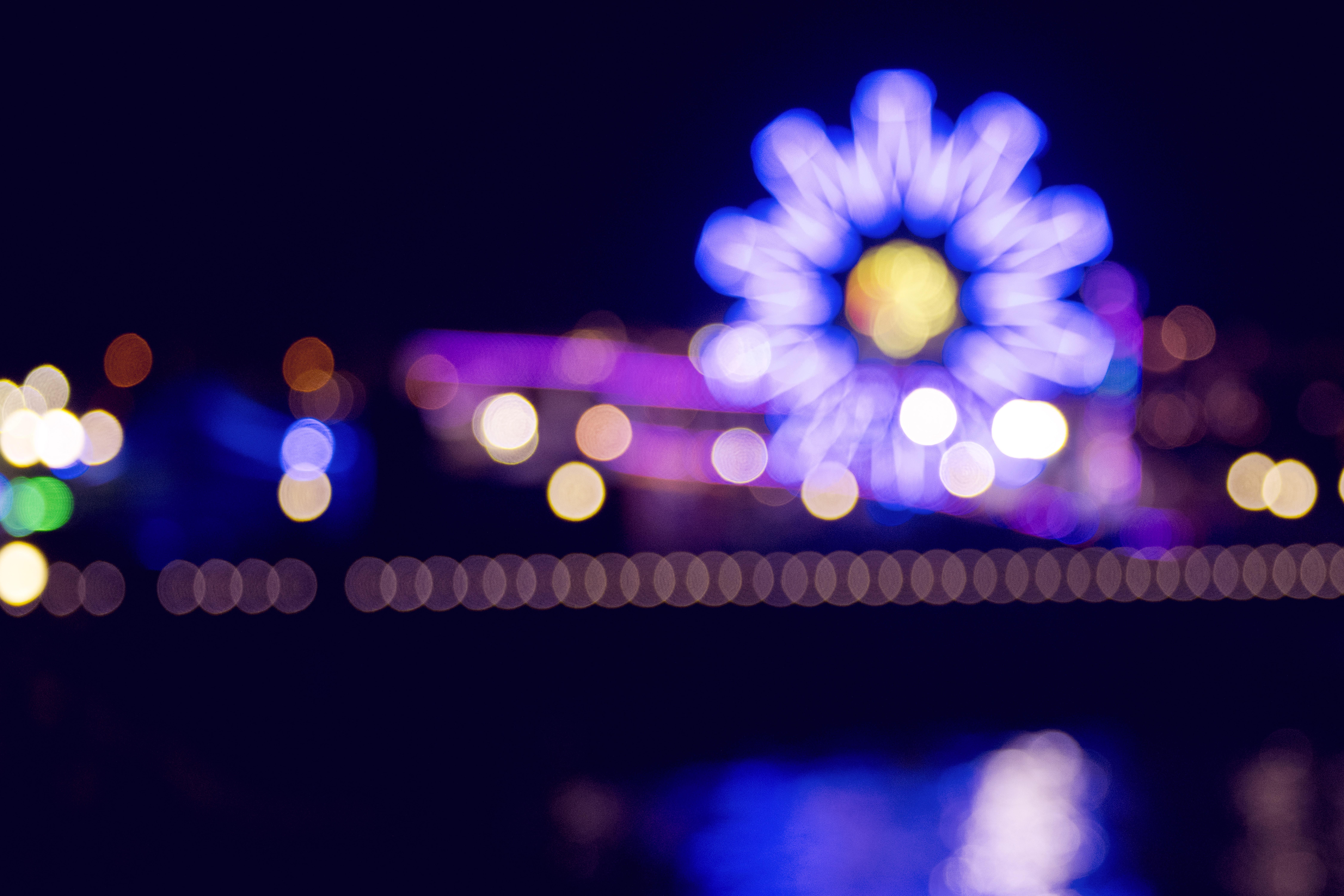 bokeh photography of ferris wheel during nighttime