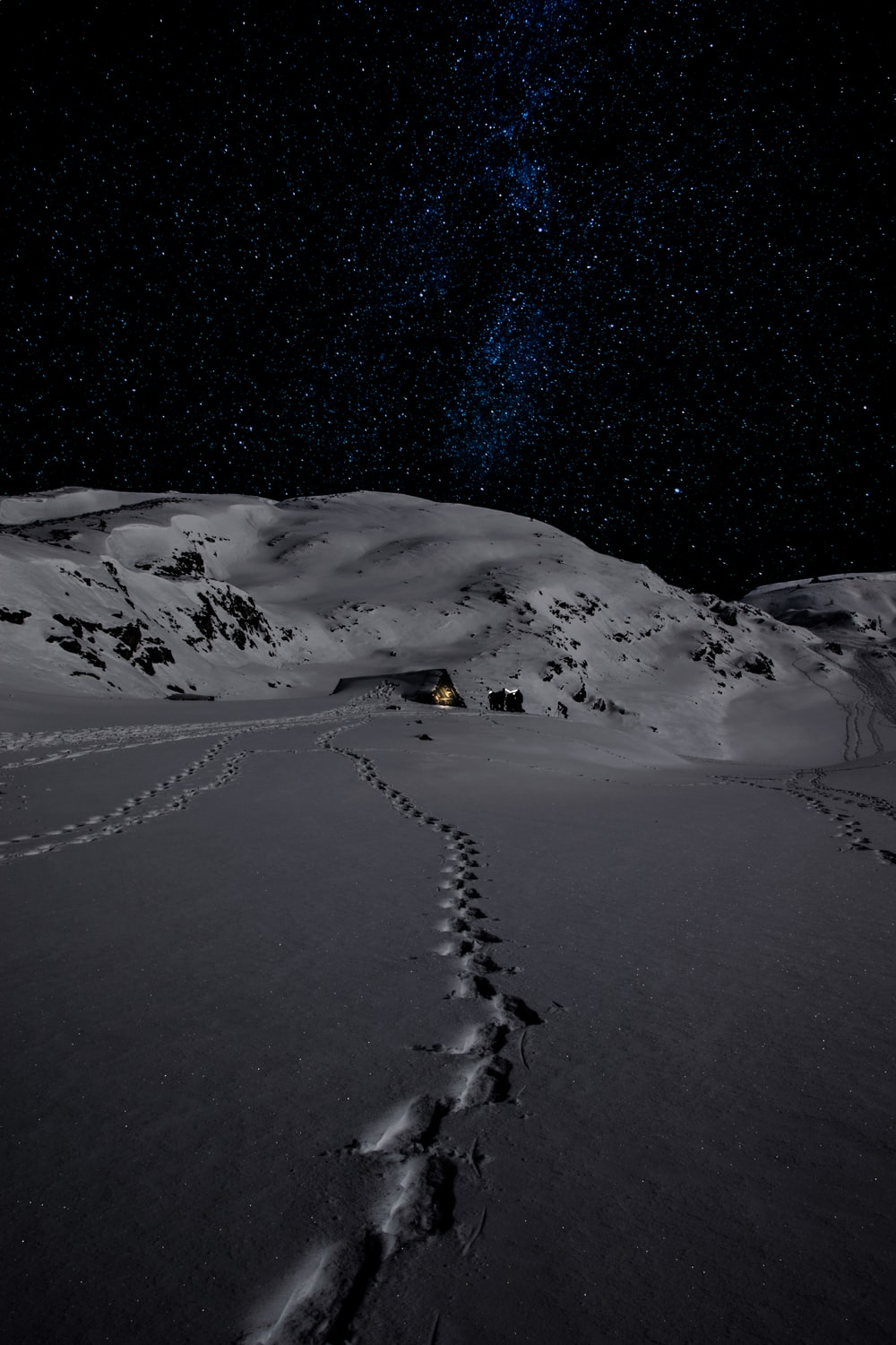 house on mountain in snow