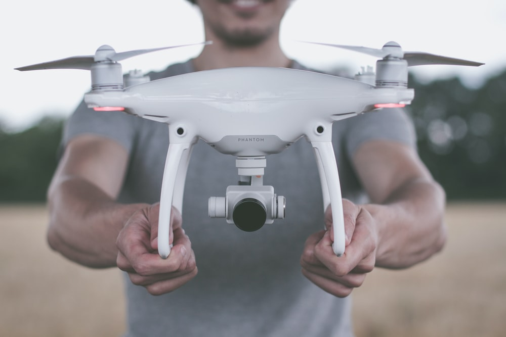 person holding quadcopter drone