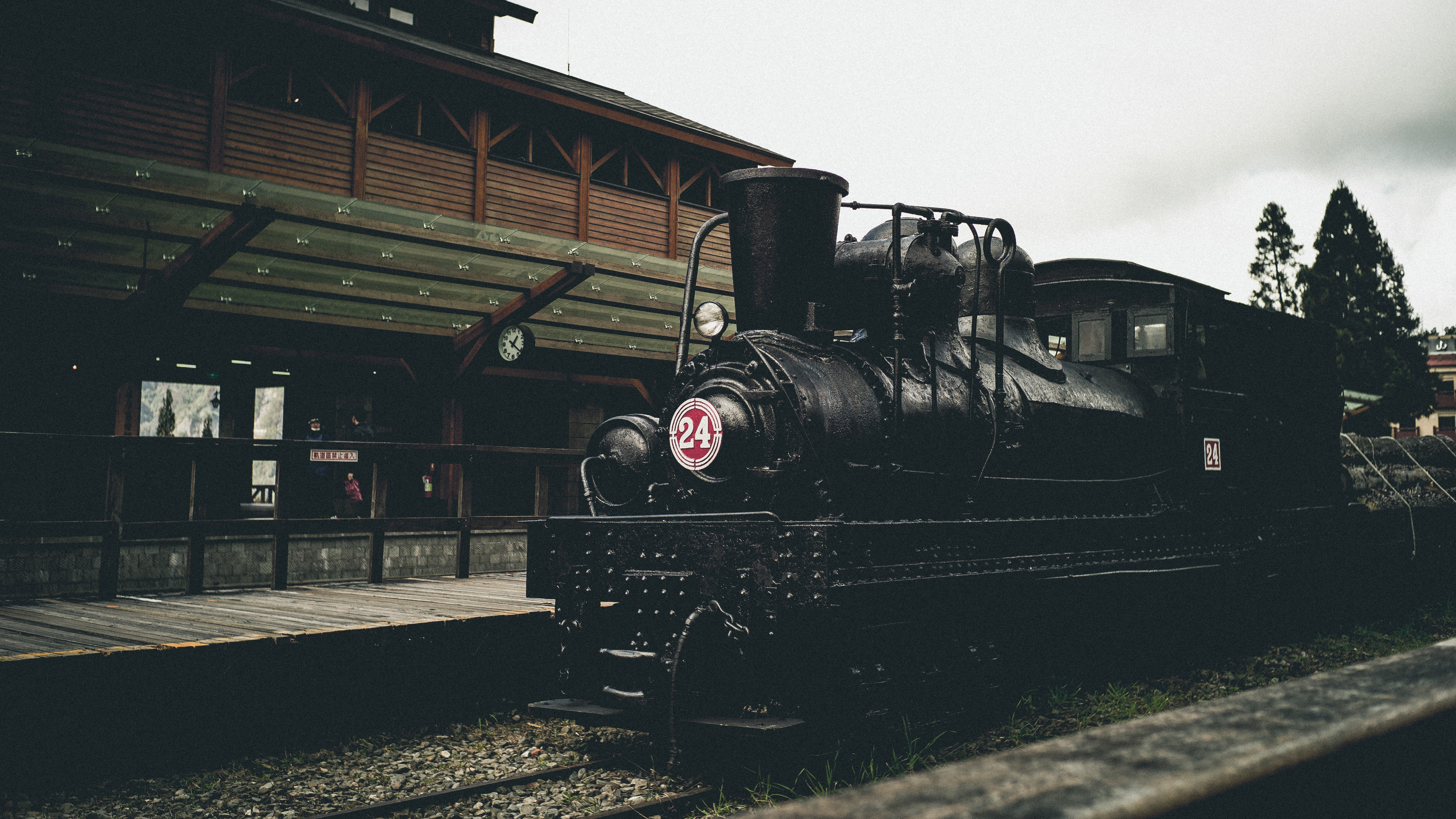 black train near brown wooden establishment