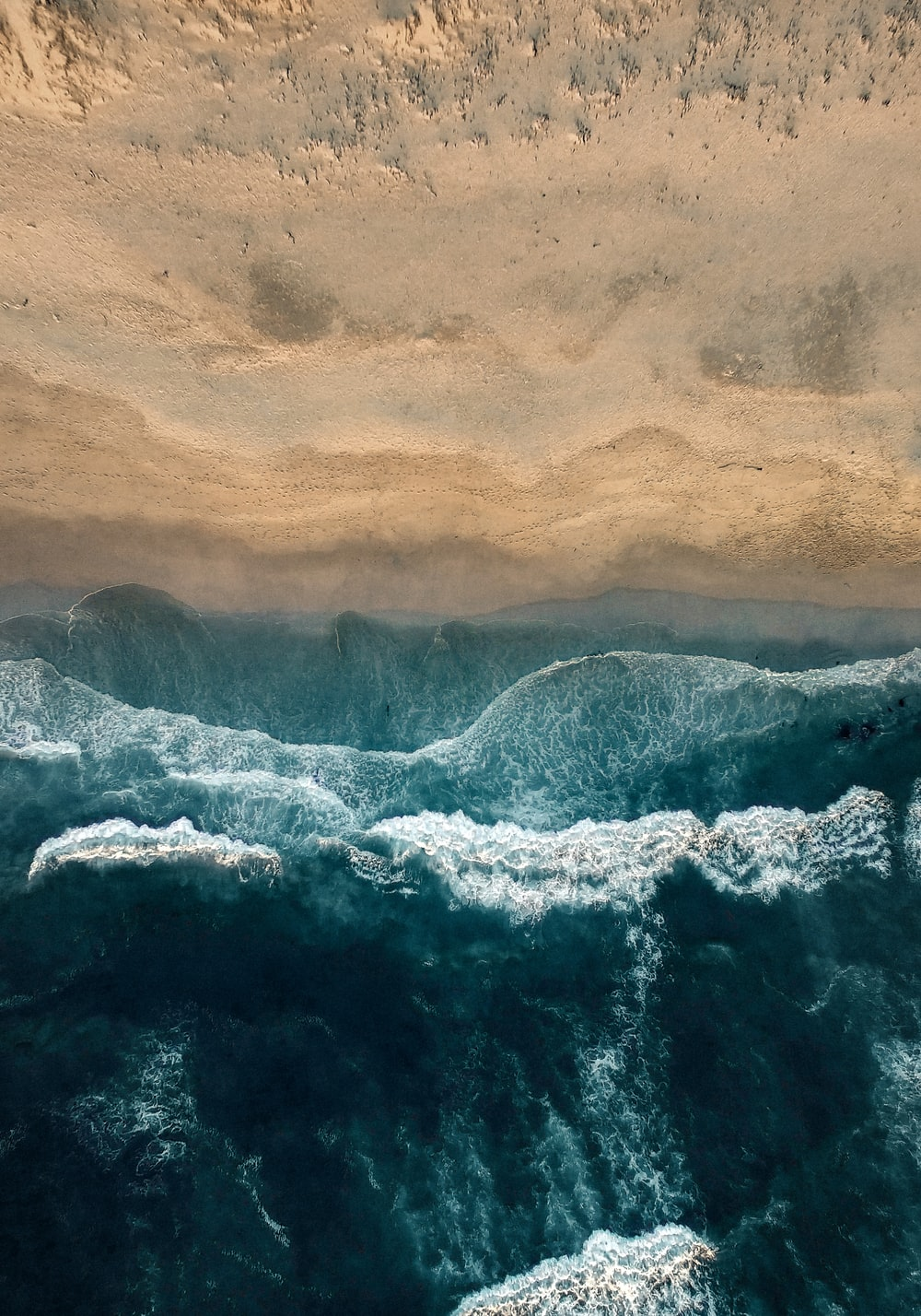 aerial photo of sea water and seashore