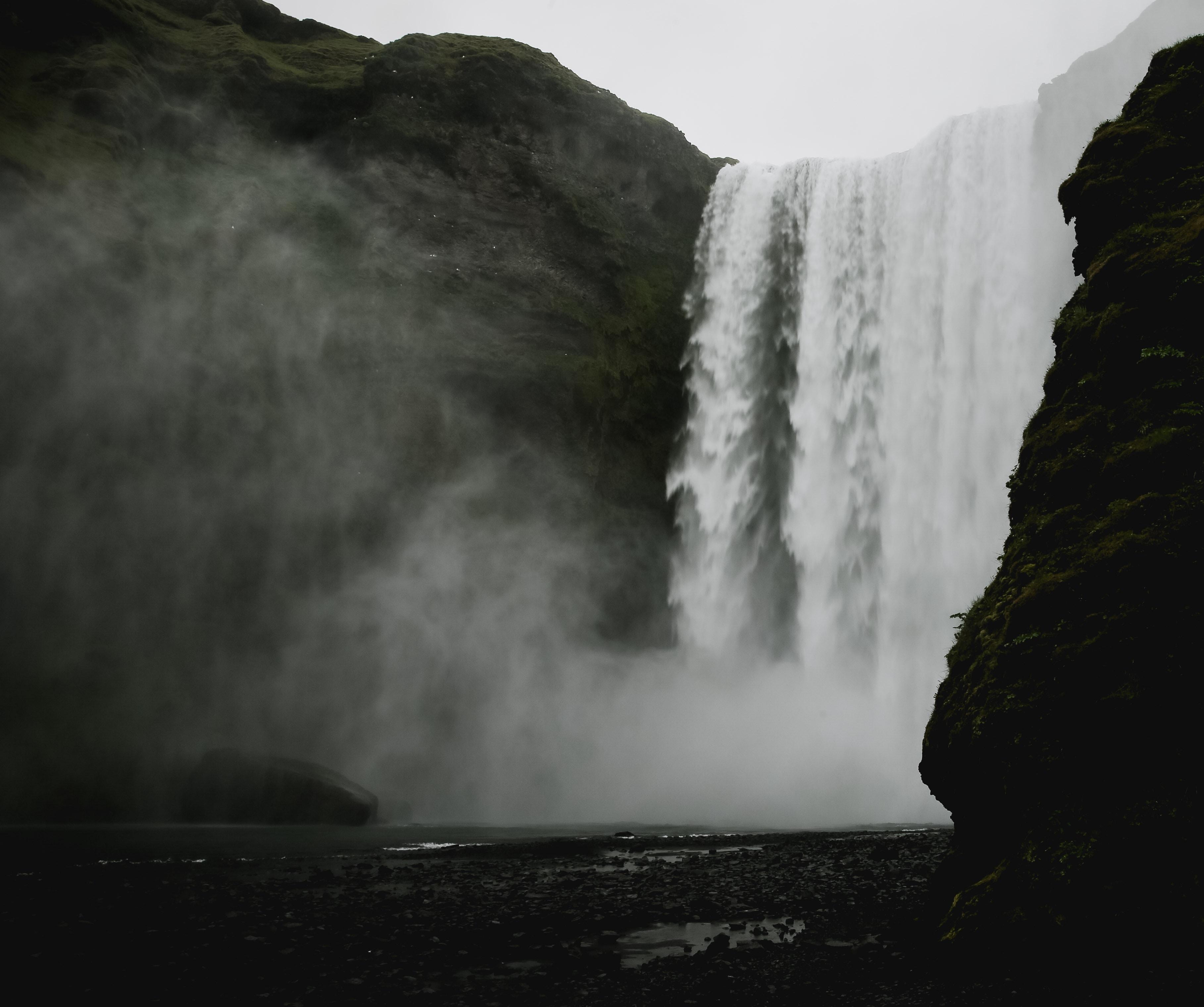 photo of mountain waterfalls