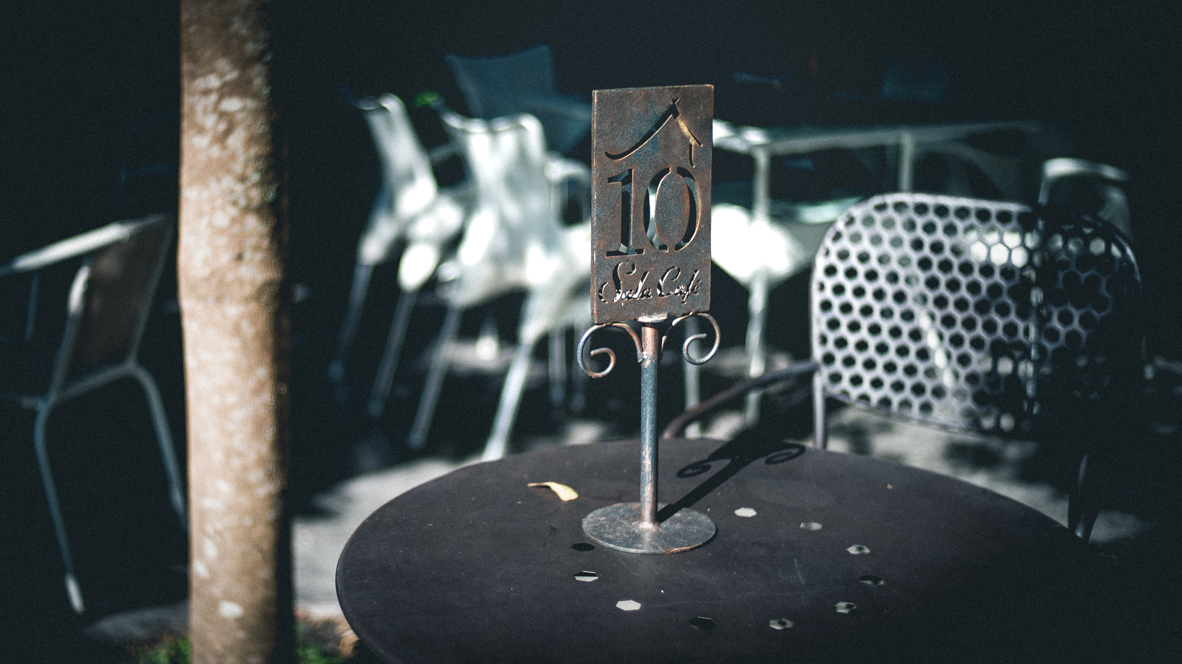 gray metal table stand on black surface