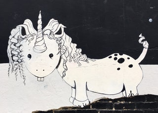 white and black unicorn mural
