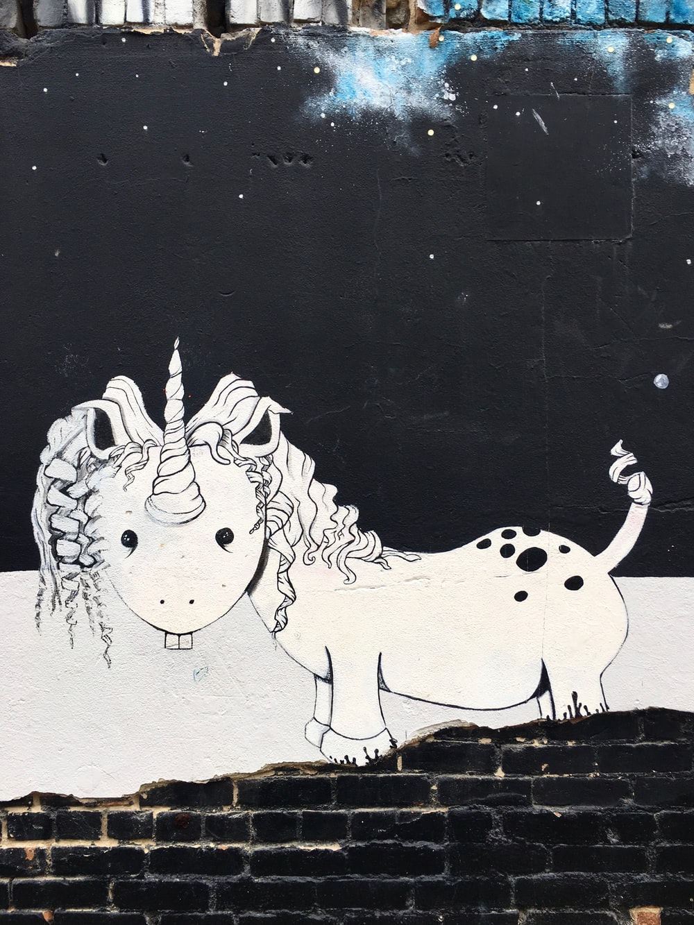 white and black unicorn mural