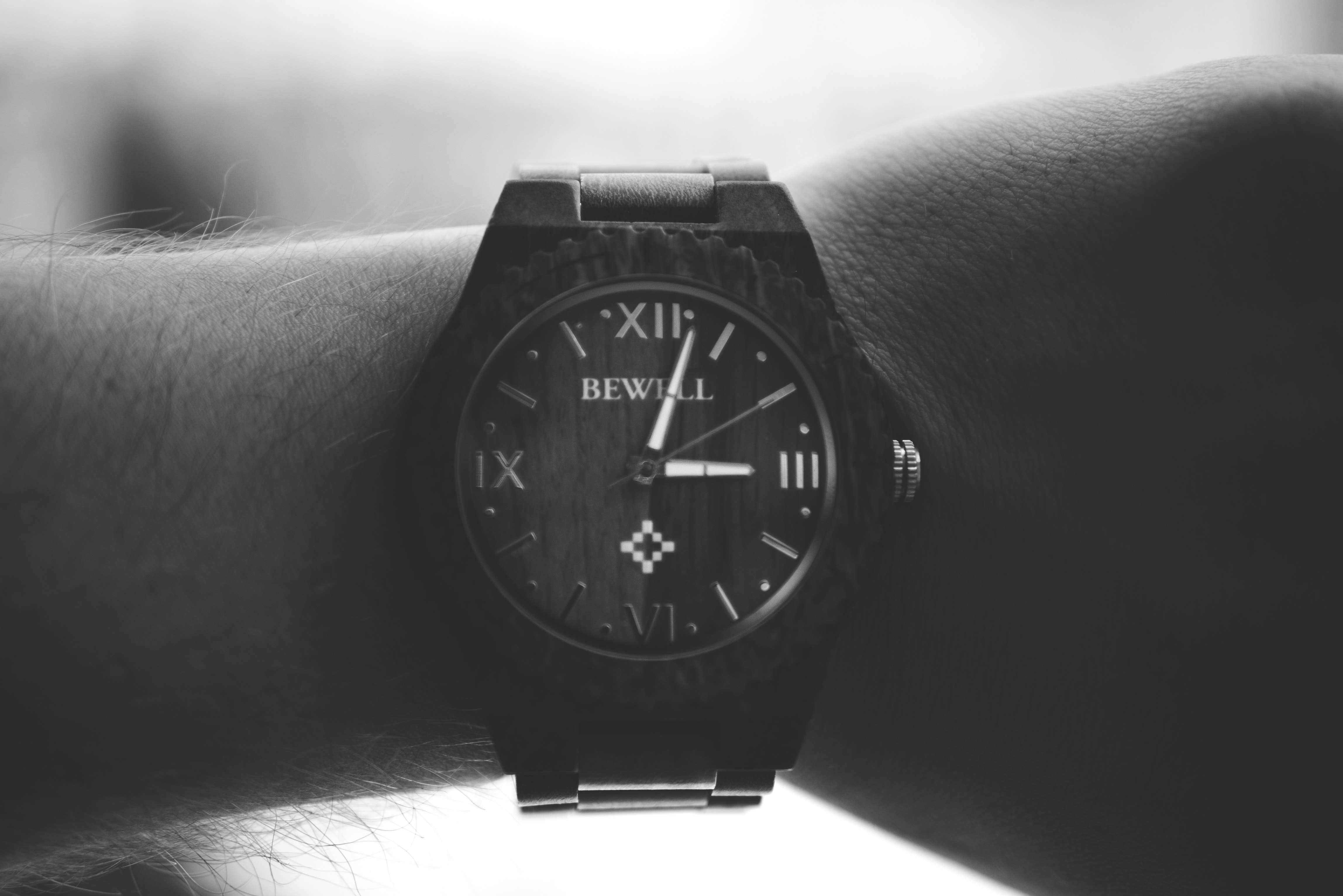 grayscale photography of person wearing black analog watch