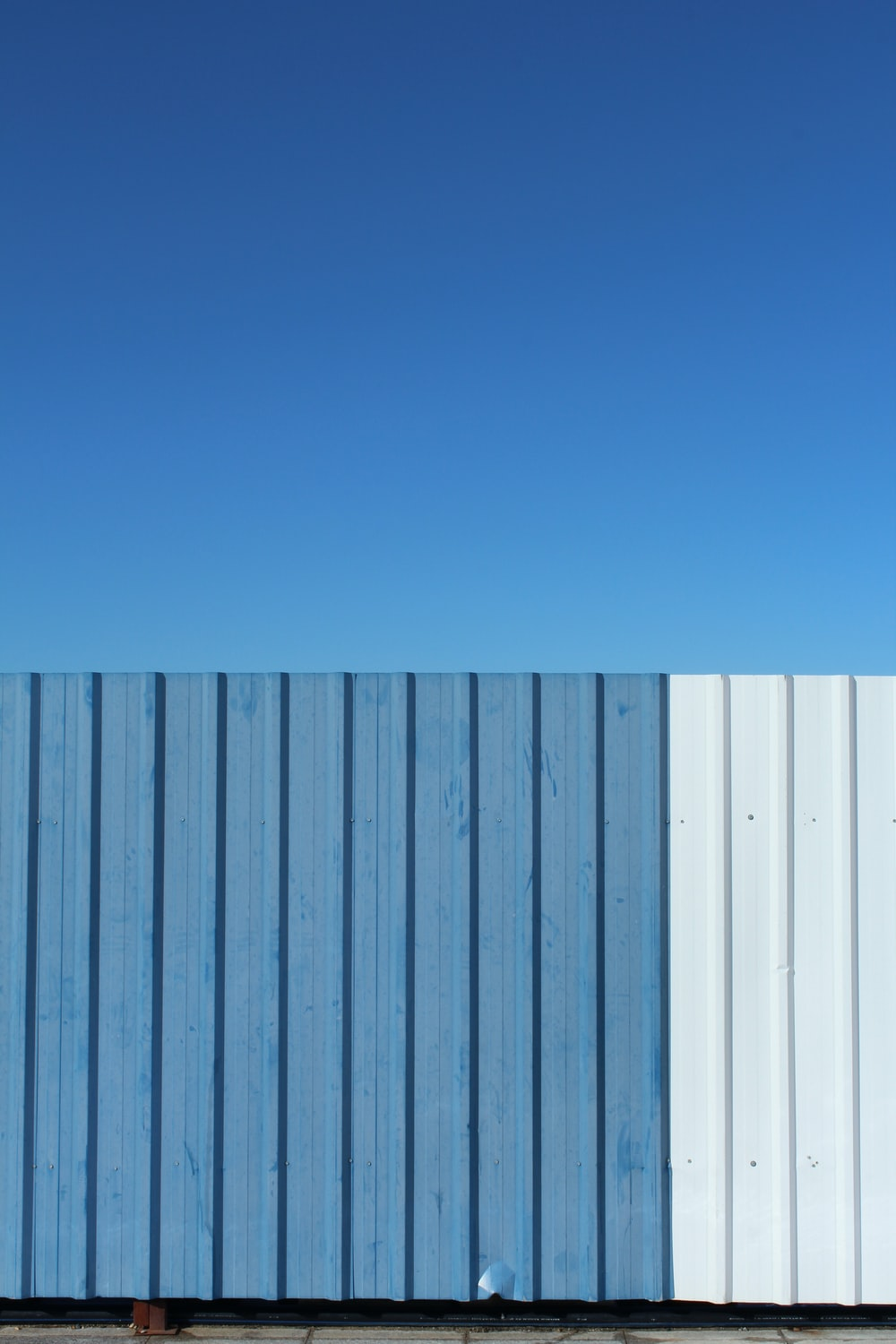 blue and white metal fence