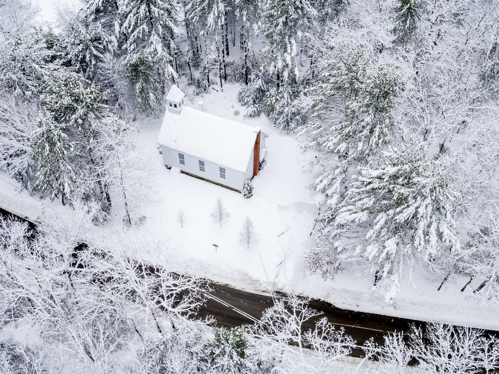 aerial photo of snow-covered building and trees