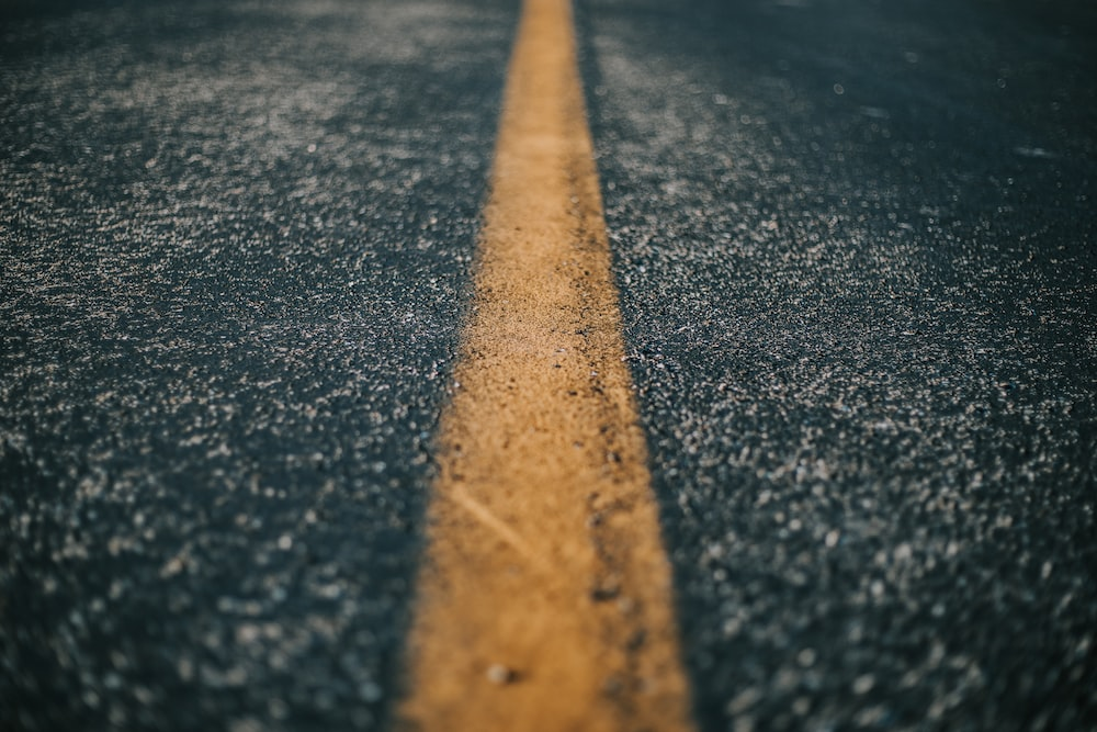 shallow focus of gray asphalt road