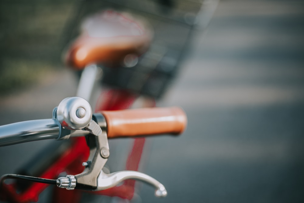shallow focus photography of bicycle brake lever