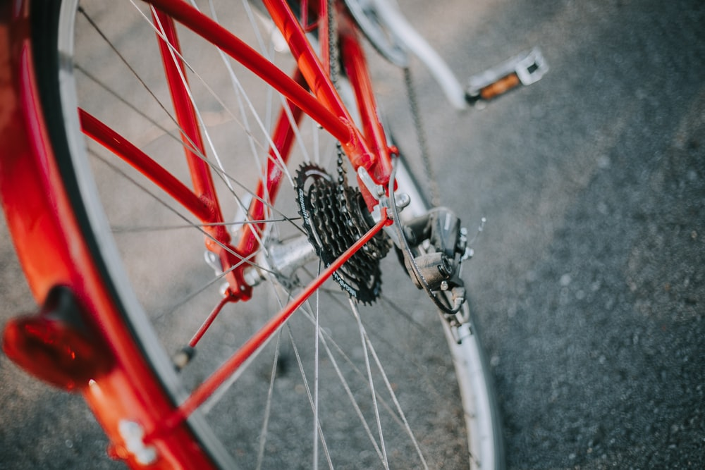 selective focus photography of red and gray bicycle
