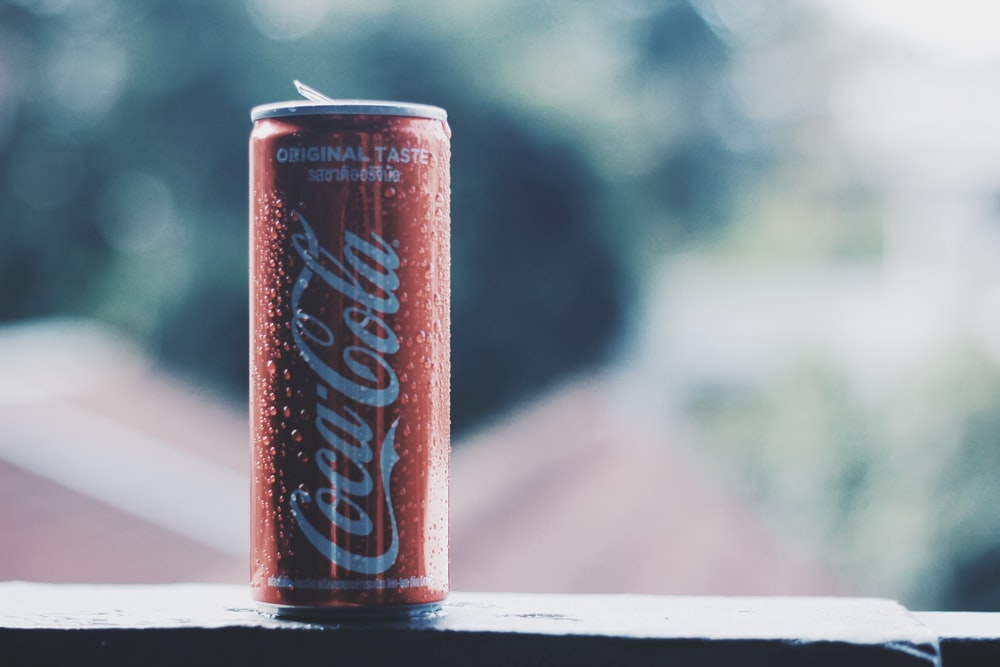 bokeh photography of Coca-Cola soda can during daytime