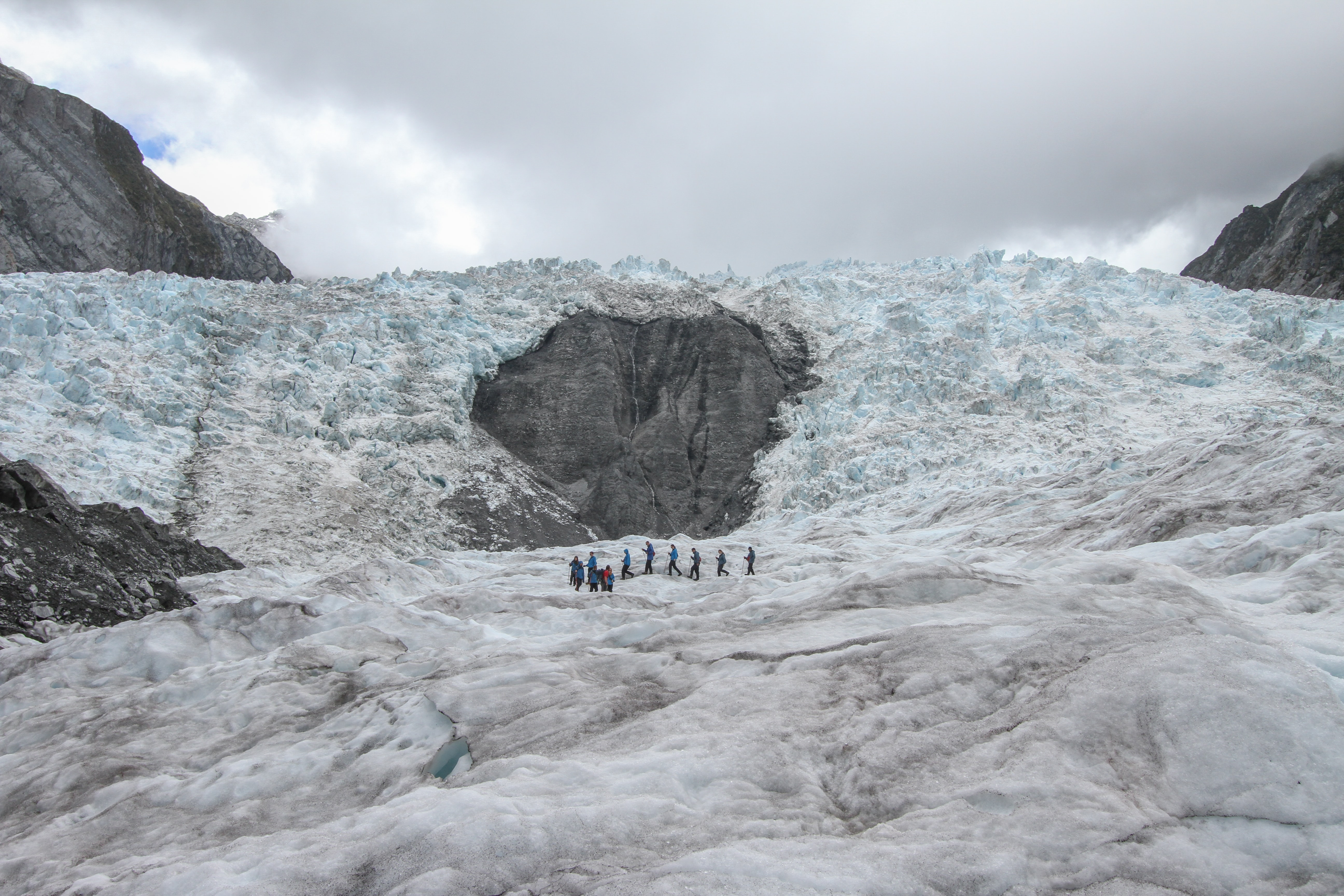 people standing on Glacier Bay, Iceland