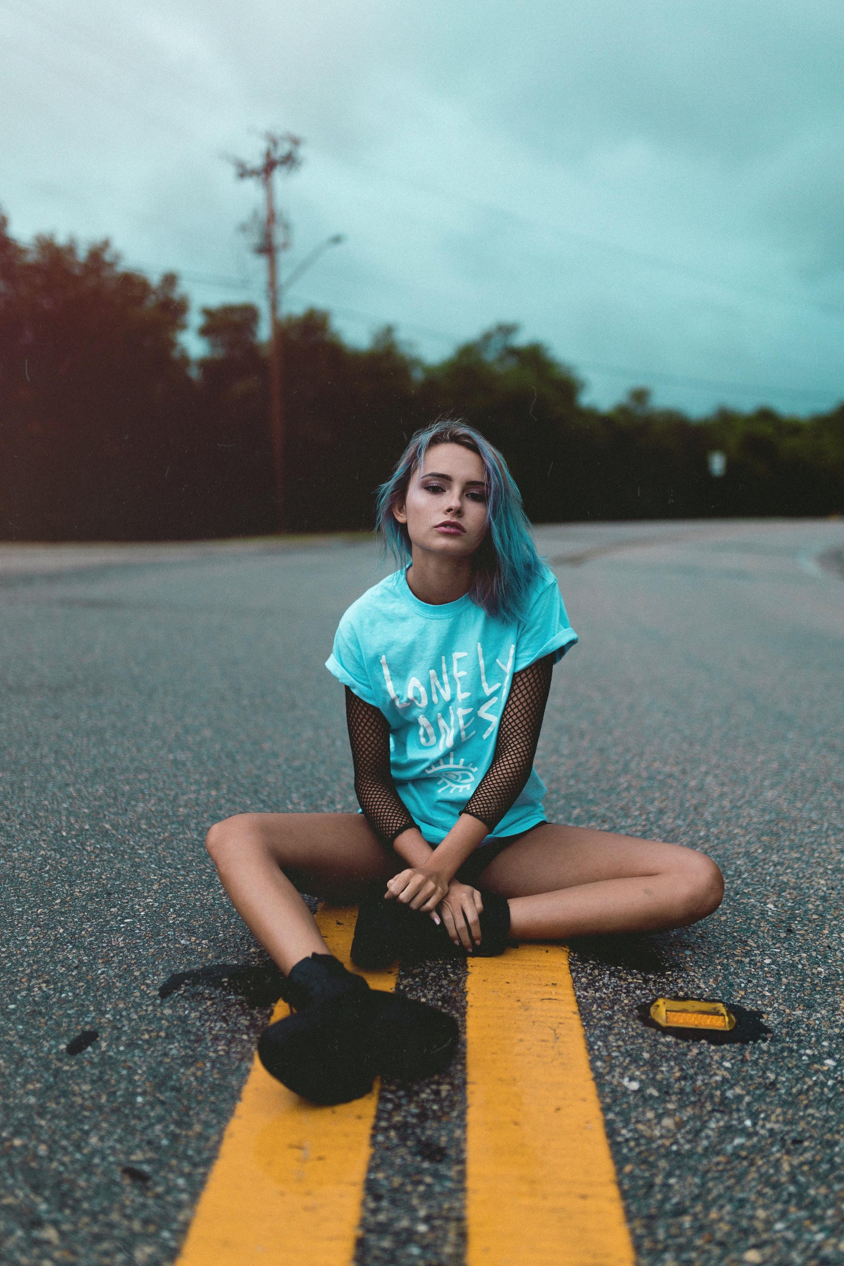 woman sitting on road
