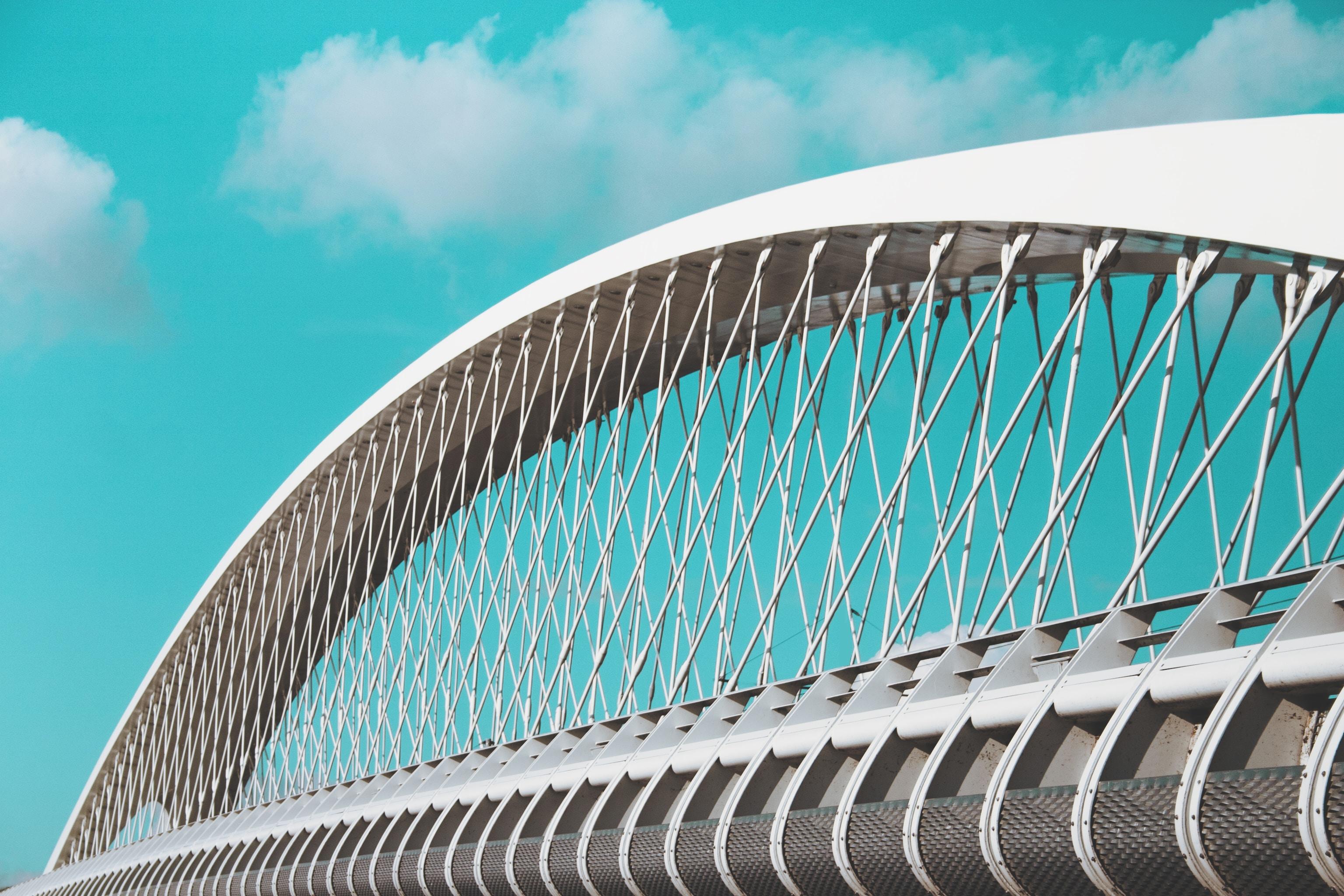 white suspension bridge under blue sky