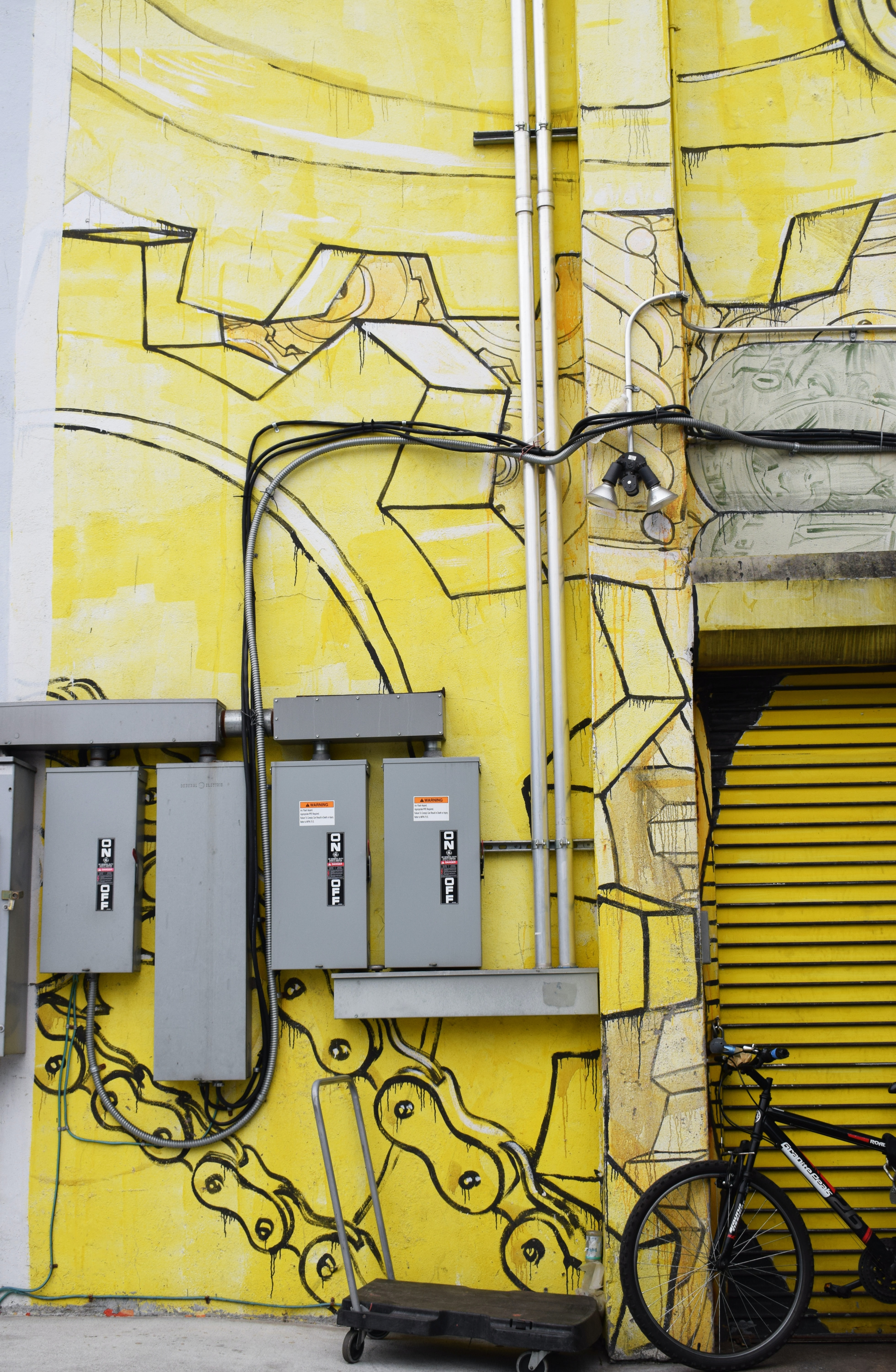 photo of grey circuit breaker case mounted at yellow wall