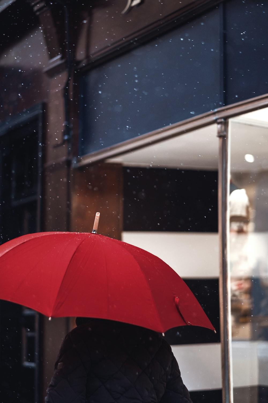 person holding red umbrella