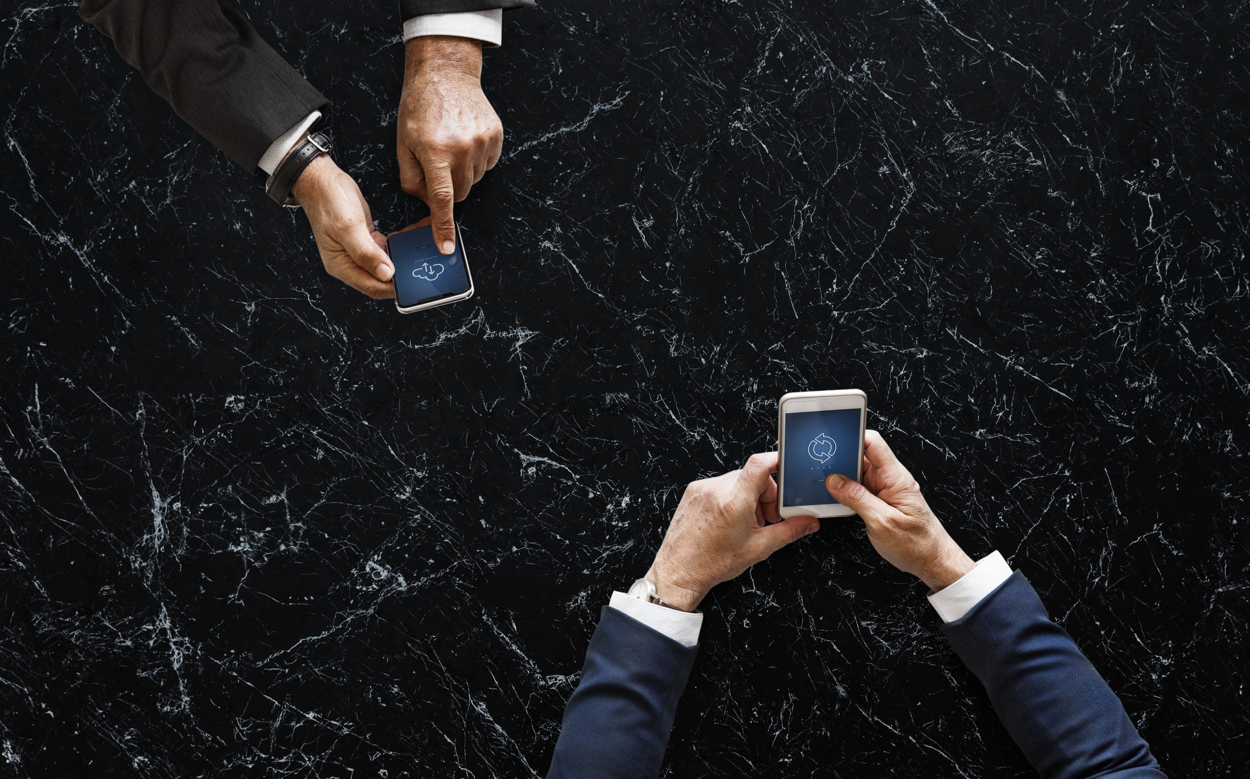 two men operating smartphones