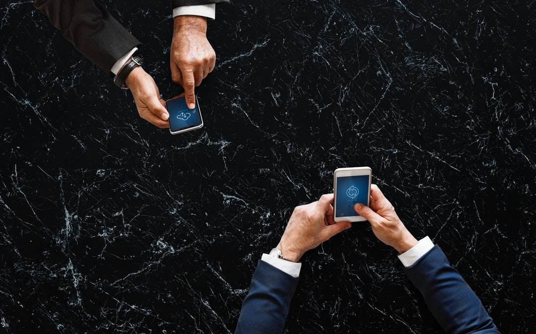 two men operating smartphones
