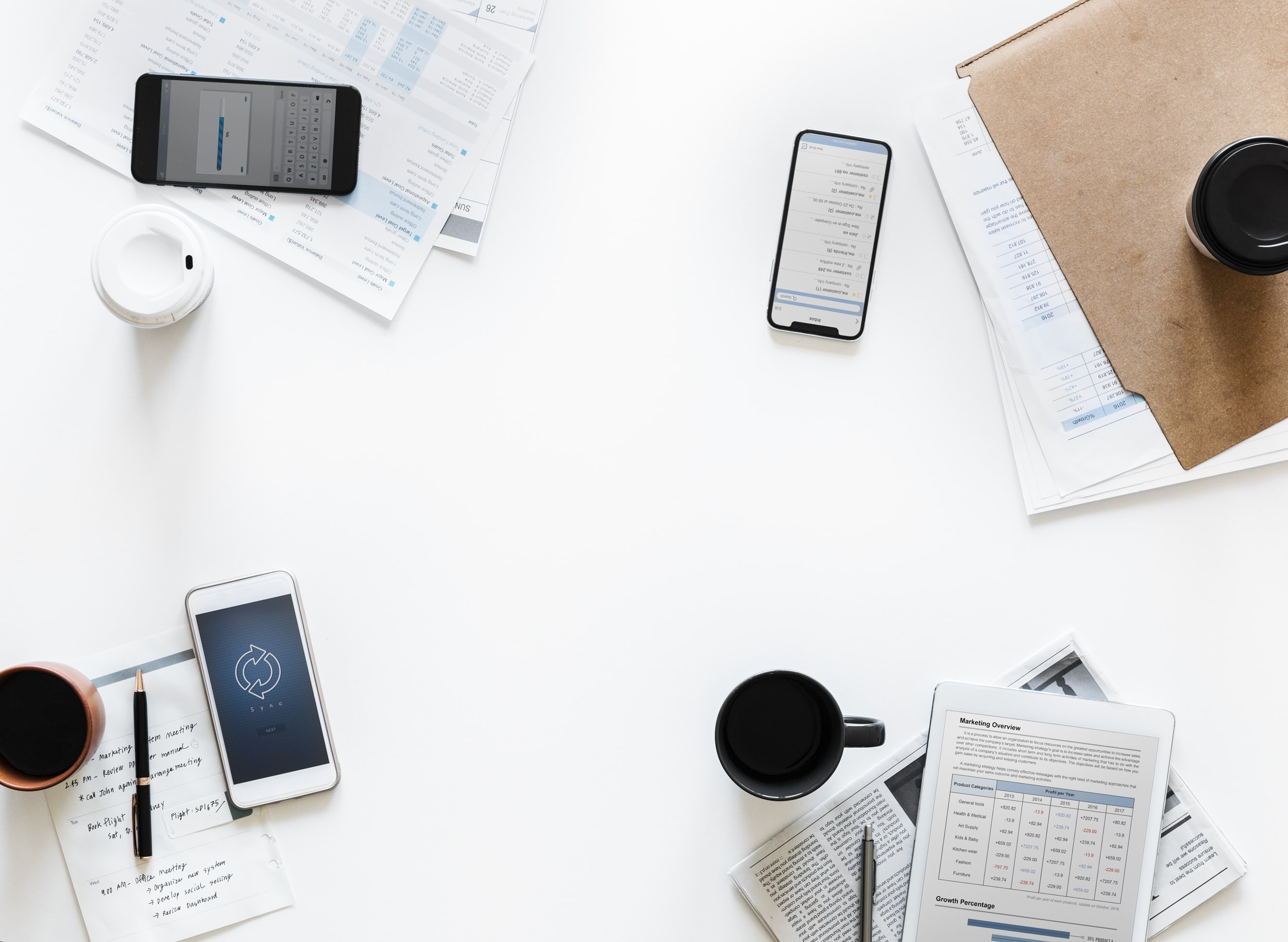 white Android smartphone near black smartphone