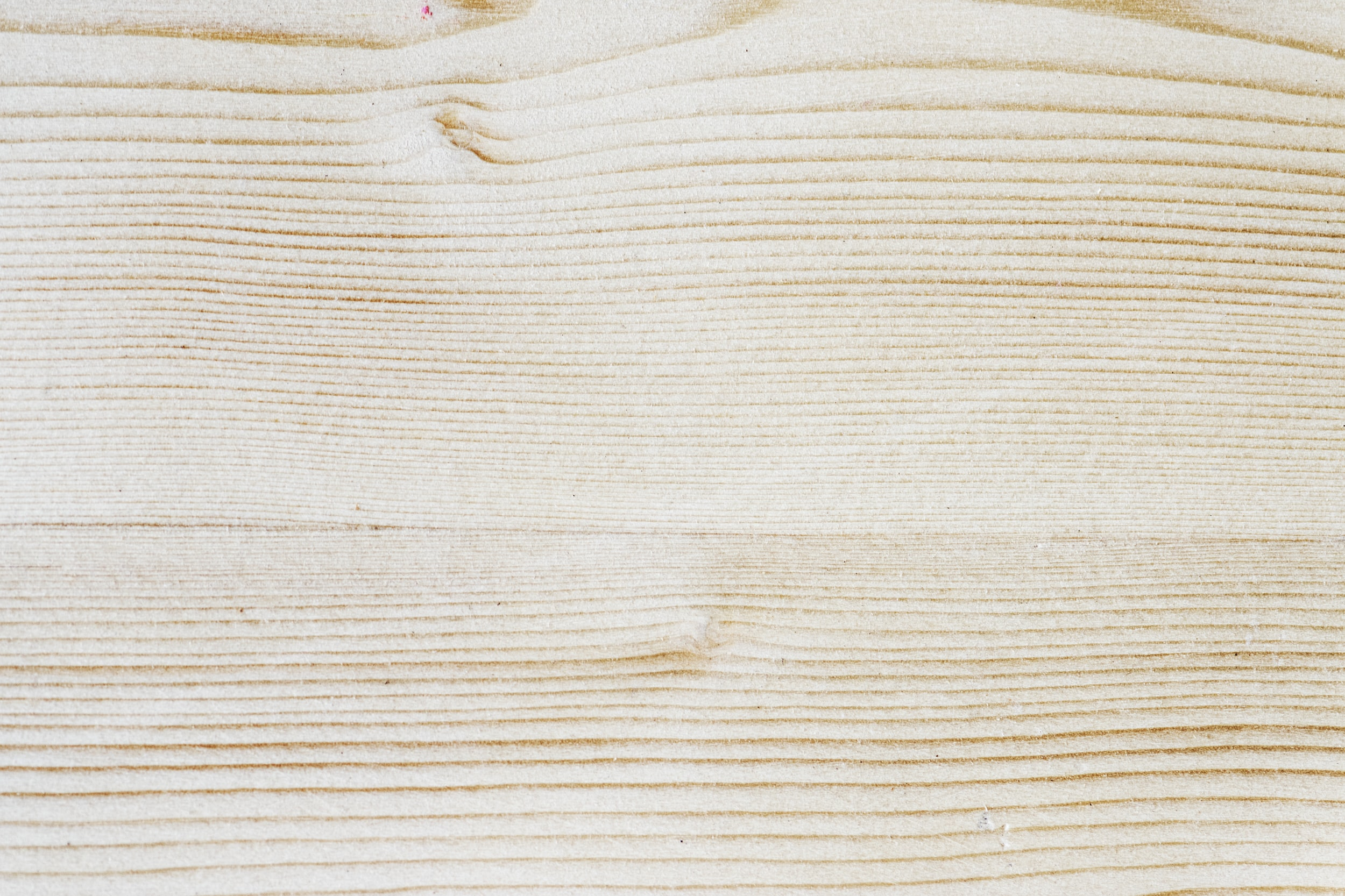 photo of white and brown plank