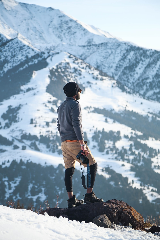 man holding camera on mountain