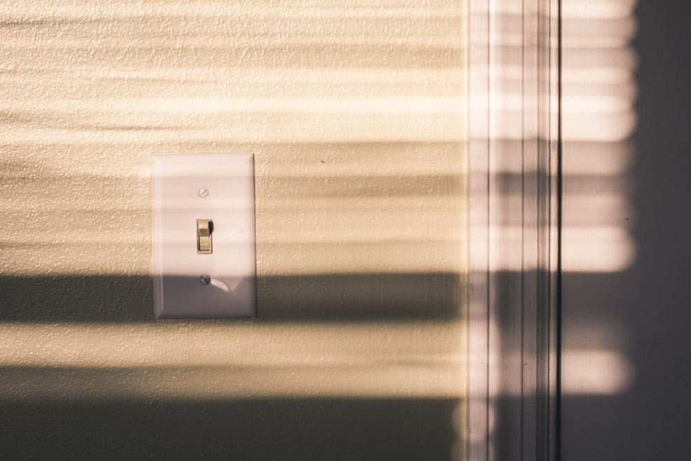 white power switch on wall