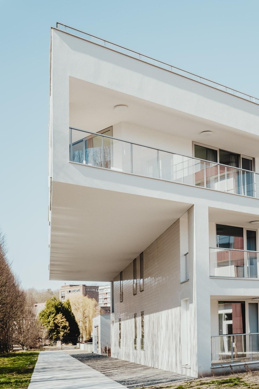 white concrete residential building near trees