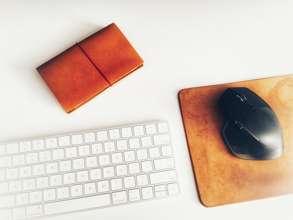 Apple Magic Keyboard beside black gaming mouse