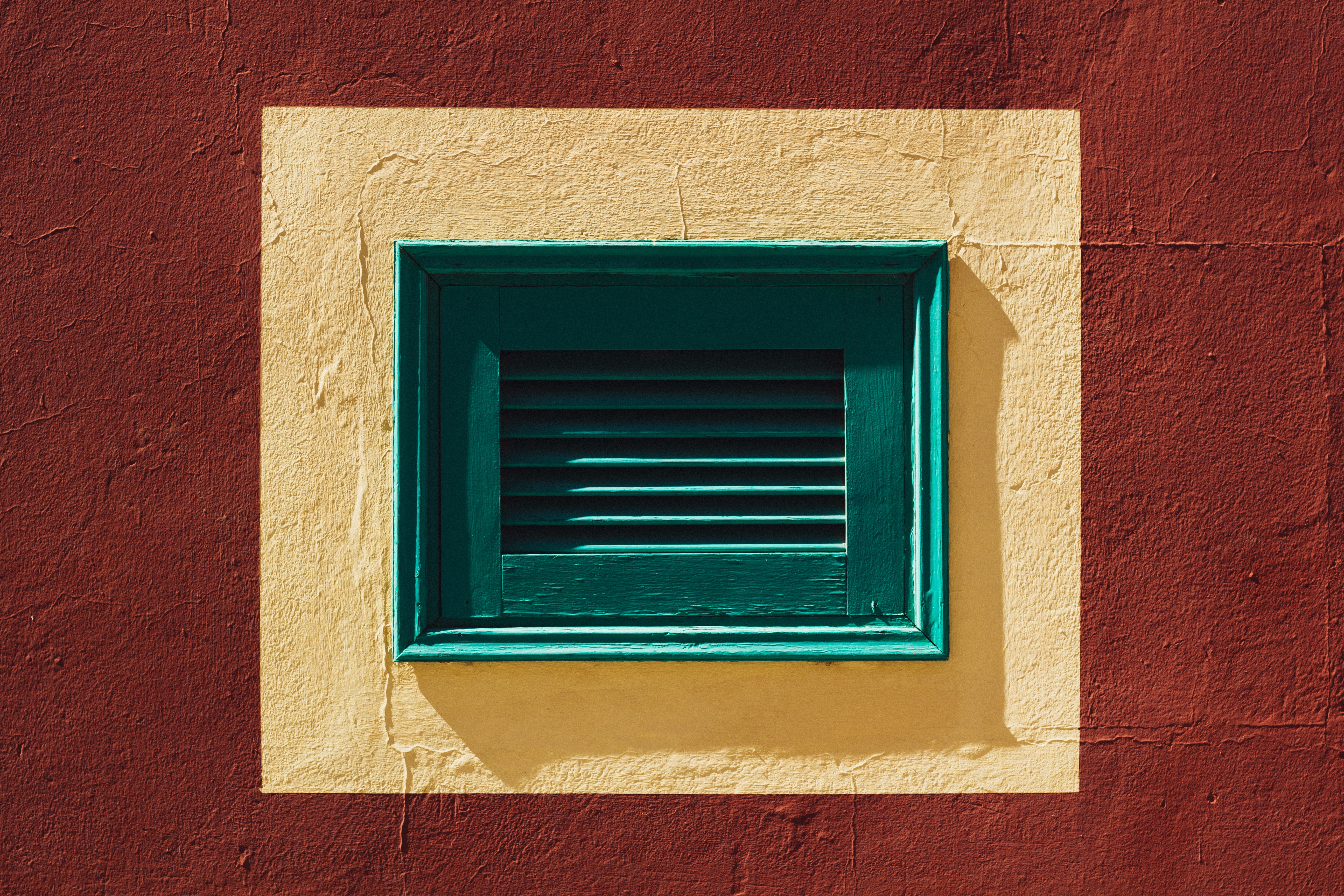 photo of green wooden window during daytime