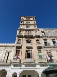 low angle view photography of brown building