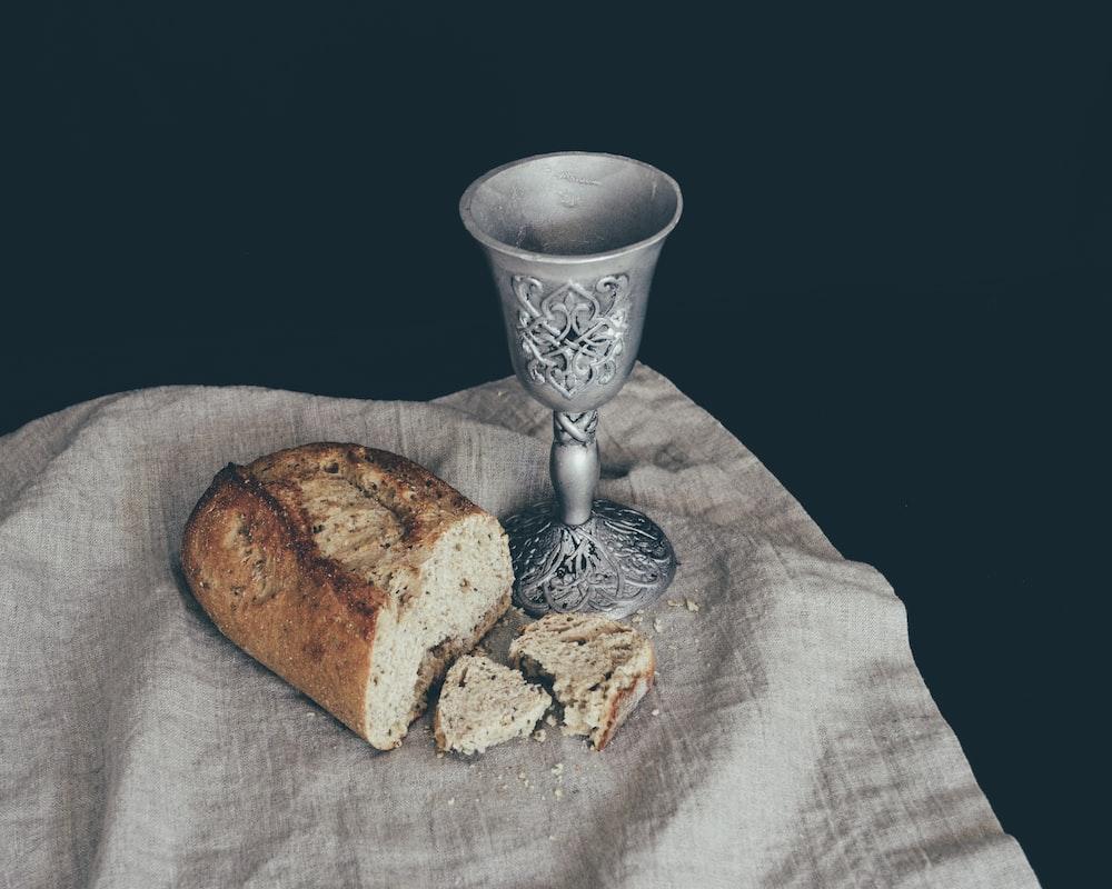 sliced of bread beside goblet