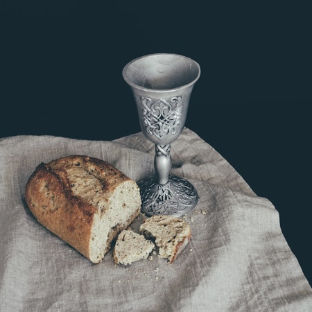 sliced of bread beside goblet