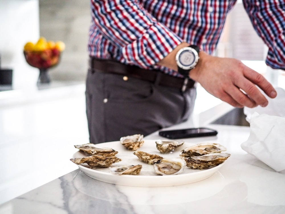 seashell dish on white ceramic platter