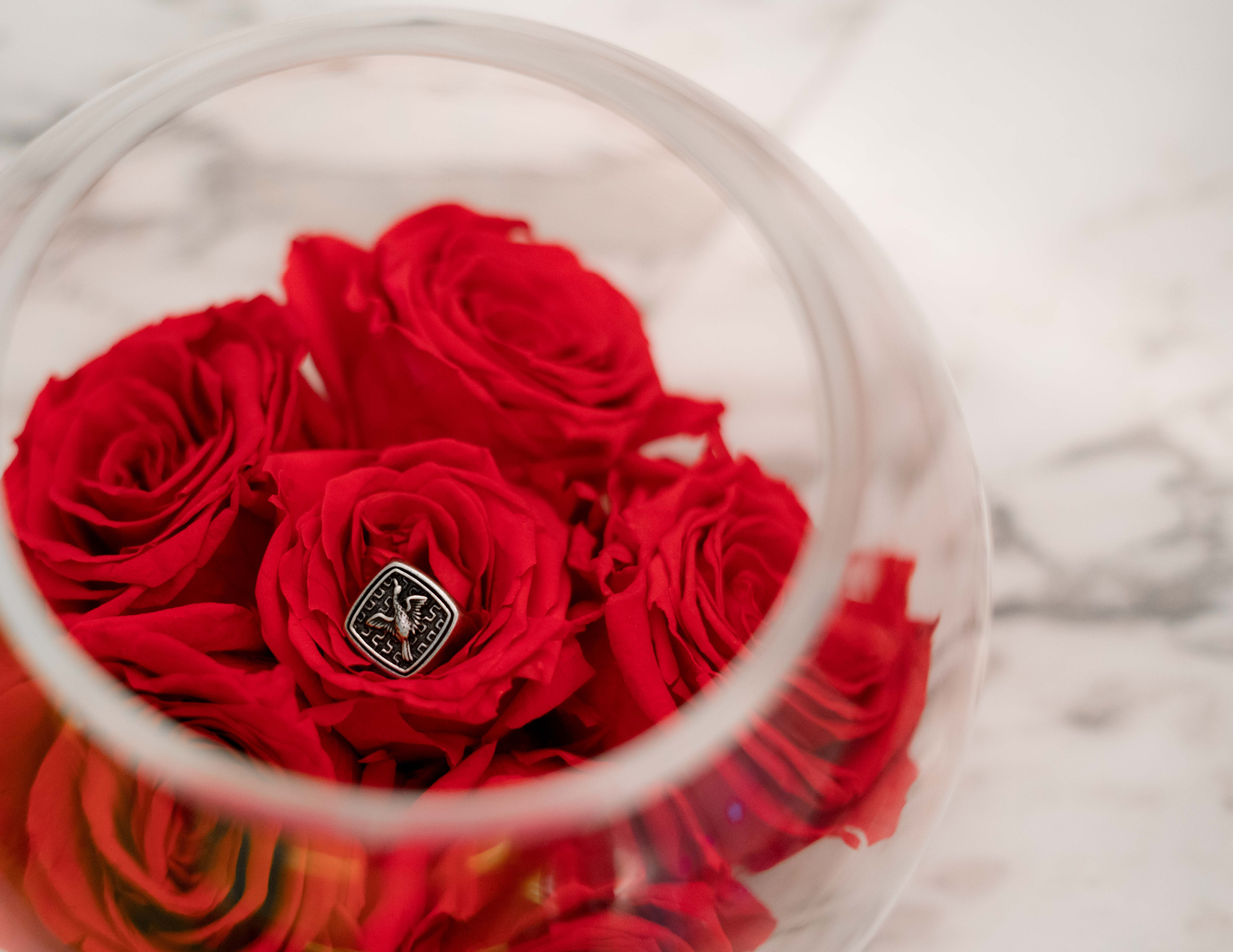 red flowers in clear glass bowl