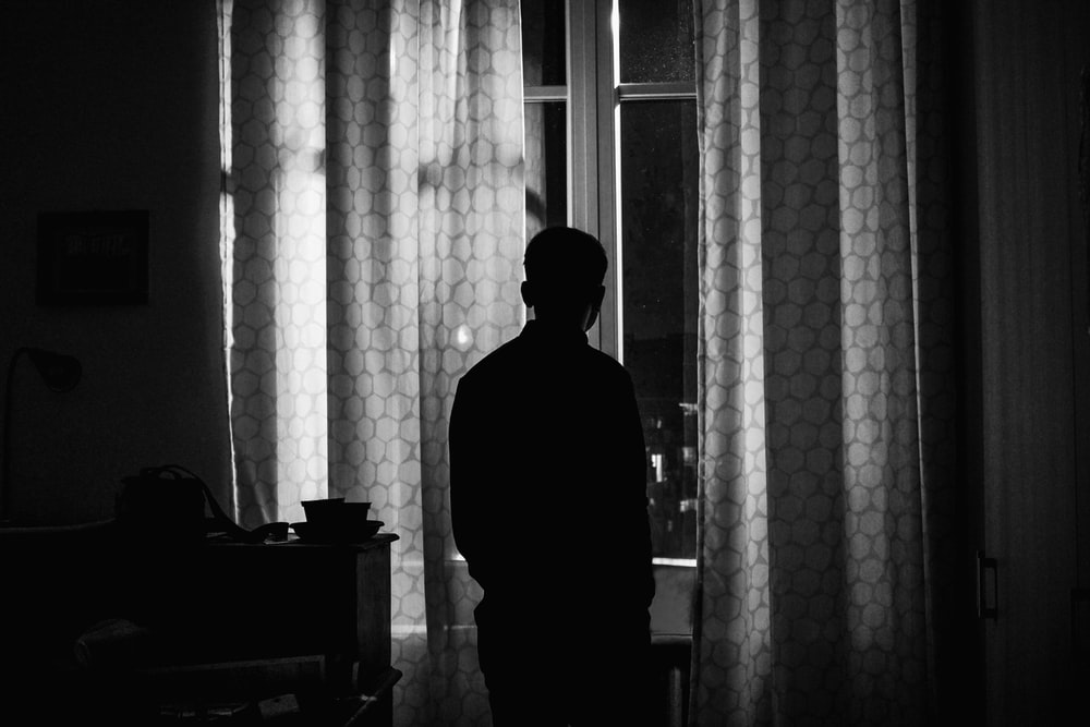 silhouette of person standing inside room