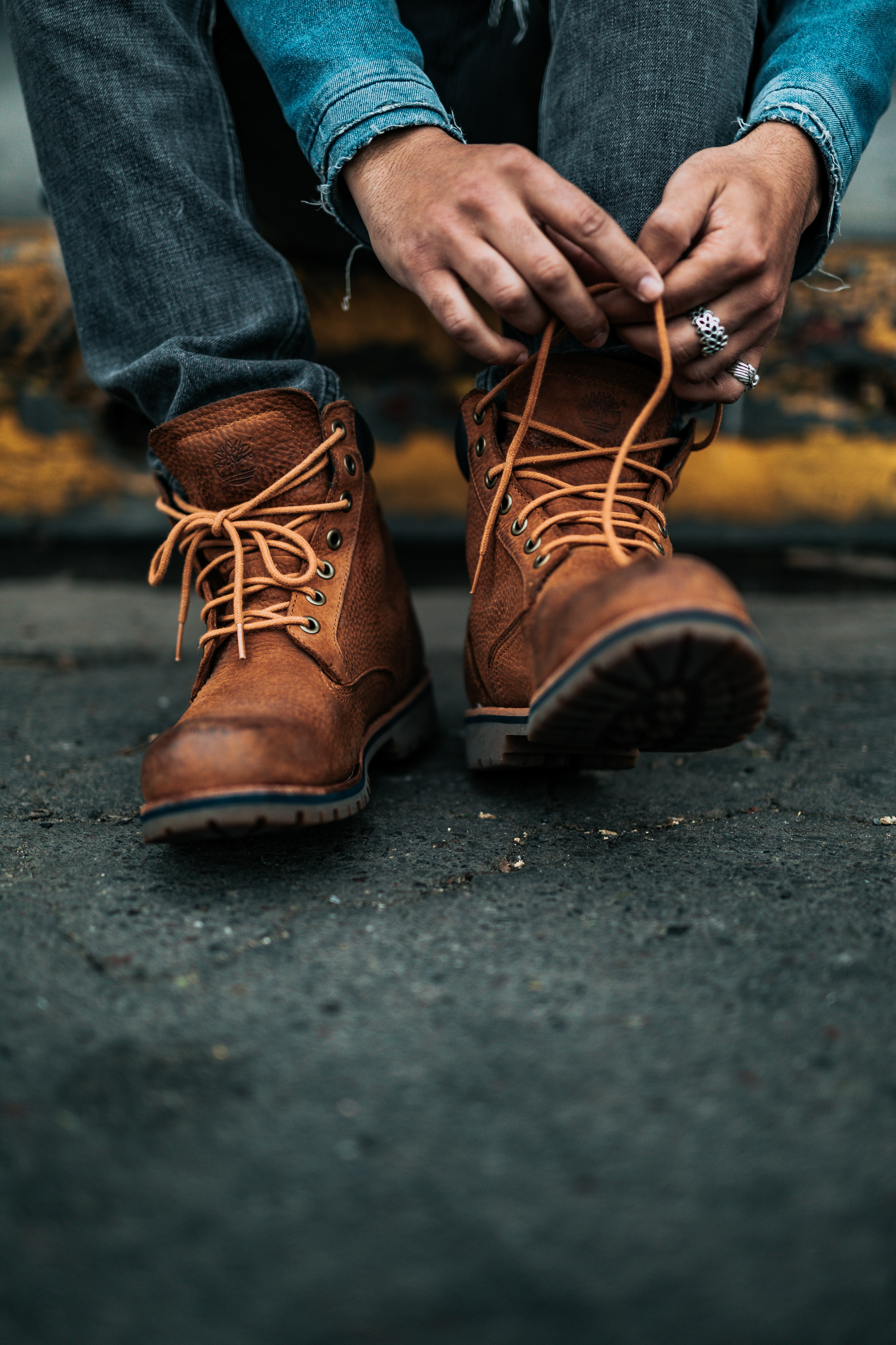 photography of person lacing his/her boots
