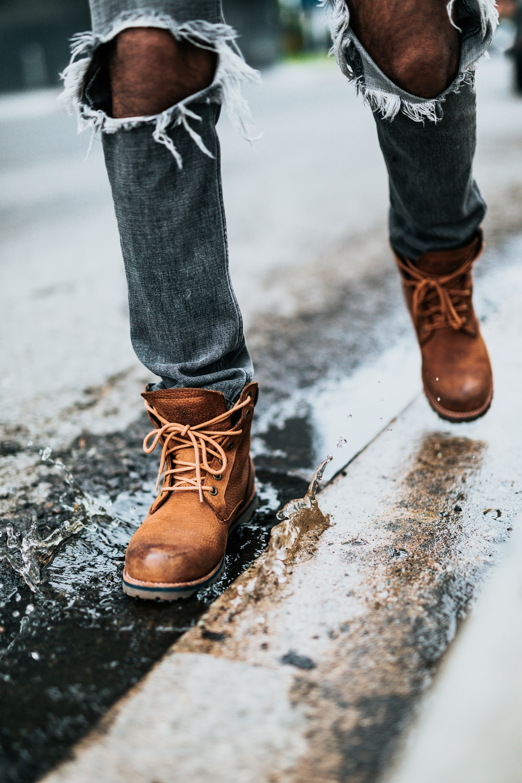 person walking on wet street
